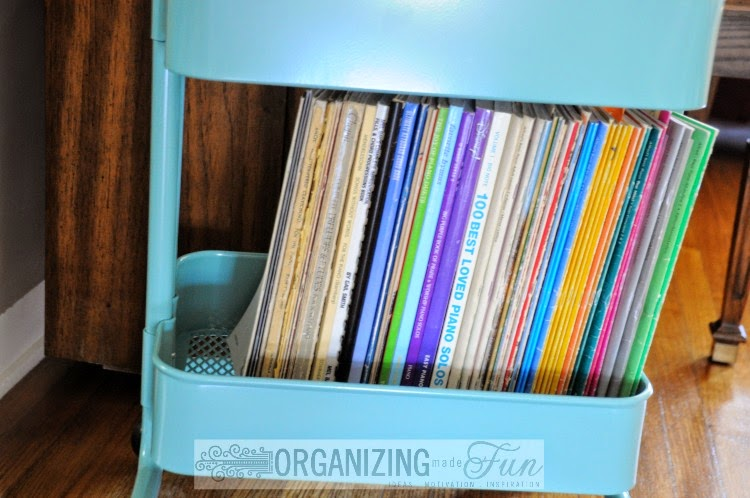 Cute, Organized Ikea Raskög Cart bottom shelf with piano books :: OrganizingMadeFun.com