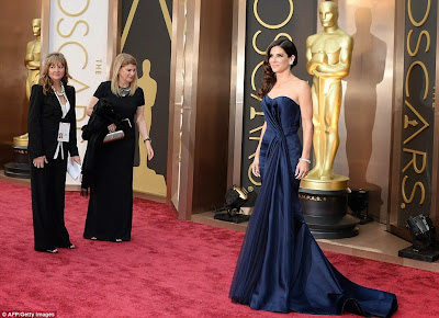 Sandra Bullock in a Navy McQueen dress at the Oscars 2014.