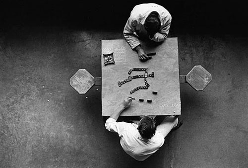 masters of photography : Danny Lyon : photo of two people playing domino in prison
