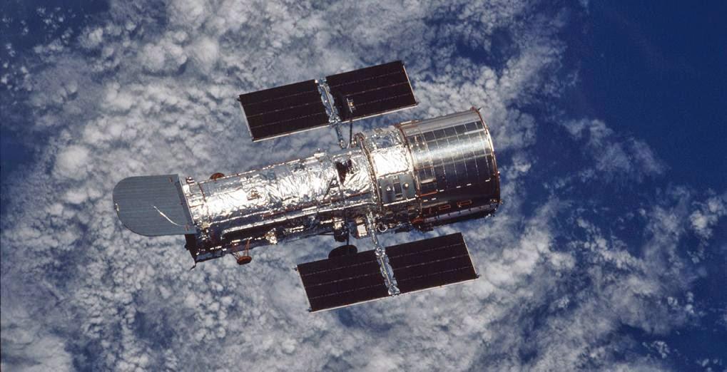 Hubble Space Telescope orbiting Earth. Credit: NASA/ESA
