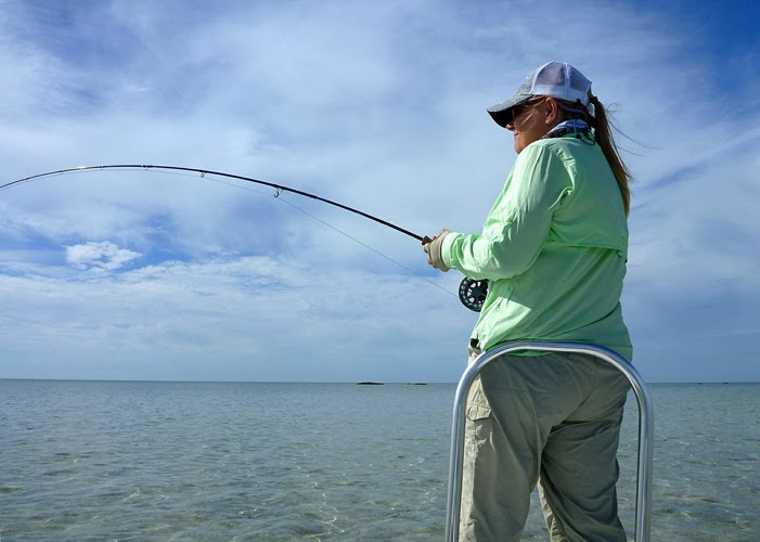 Shannon Brightman fighting and landing another Abaco bonefish