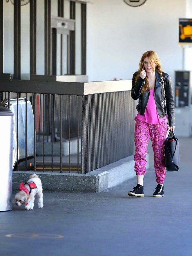 Bella Thorne was all smiles as she arrives to the airport at Los Angeles on Friday, February 13, 2015.