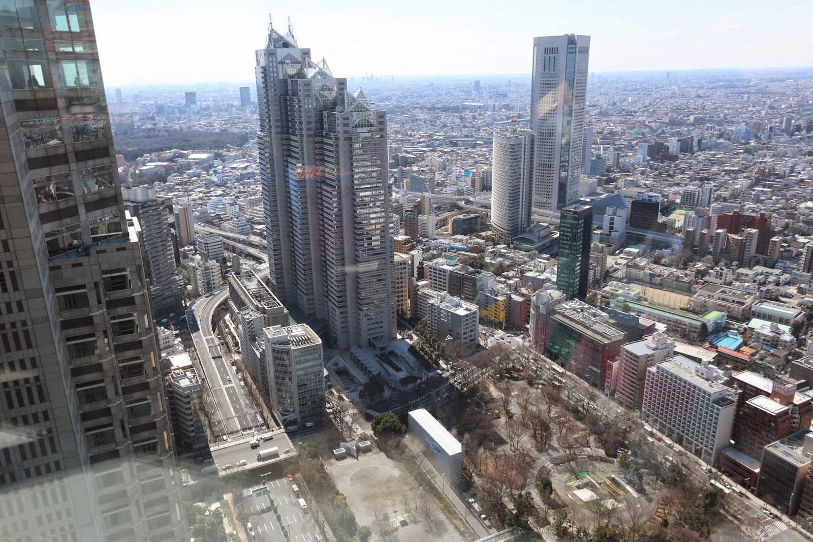 Shinjuku Park Tower (235m) & Tokyo Opera City Tower (234m), the skyscrapers in Shinjuku Business District at observation deck in Tokyo