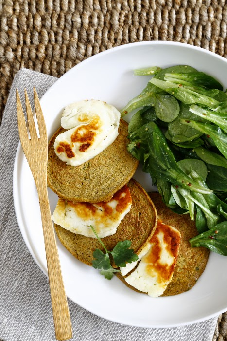 Lunch bowl of carrot pancakes and halloumi slices and a green salad