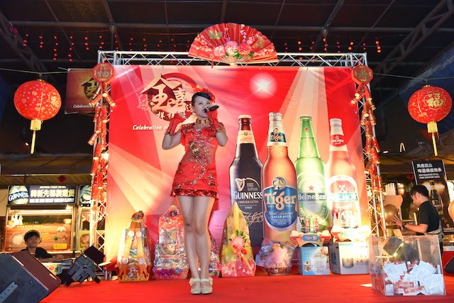 "Crowd entertained by song performances during Tiger Beer's ""Celebration of Golden Prosperity"" on-ground event"