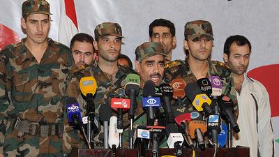 la proxima guerra grupo rebeldes combatientes vuelve al ejercito sirio Khaled Abdel Rahman al-Zamel dejan la lucha armada oposicion