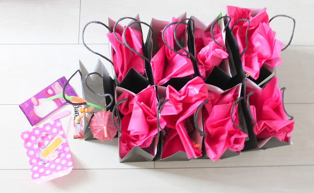 personalised pre filled black & pink hen party goody bags with umbrella straw