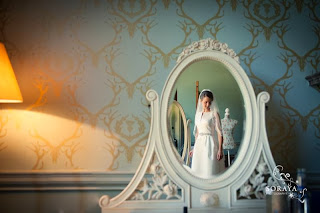 Bride reflected in a vintage mirror in a Stately home in Scotland, Fasque