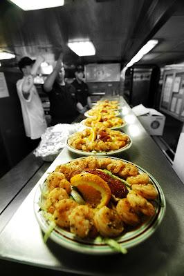 Preparing gourmet meal in the galley