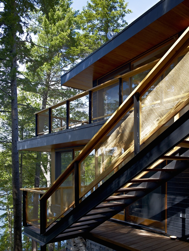 Photo of steel and wooden exterior staircase to the upper floors of the forest house
