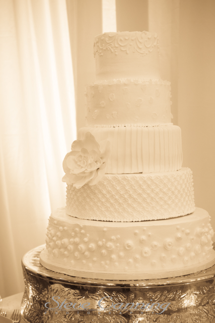Silver cake stand is part of the inventory at Elizabeth Bailey Weddings