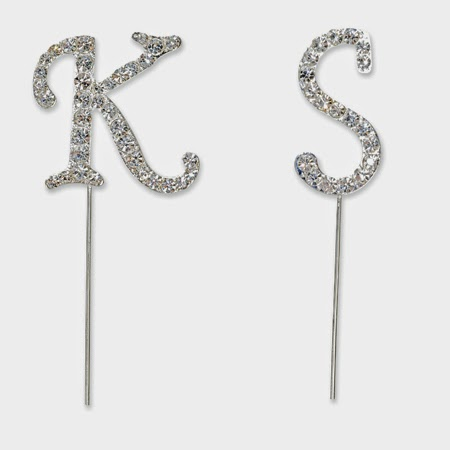 http://www.tiptopweddingshop.co.uk/products/Diamante_Monogram_Initials_Wedding_Cake_Toppers_small-4820-0.html#.U3TG8Xazwis