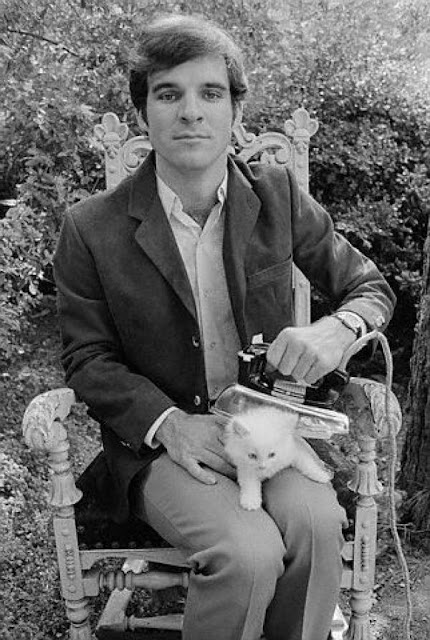 A young Steve Martin ironing a cat, 1970s