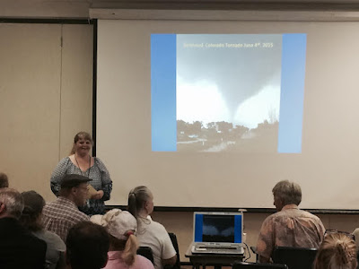 photo of Lori Hodges, Larimer County Emergency Manager, speaking at Disaster Assistance Center