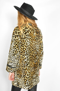 Vintage 1960's leopard print faux fur coat with black leather trim and black button closure.
