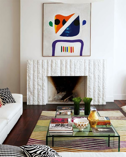 this buenos aires home remodeling project left the original fireplace untouched