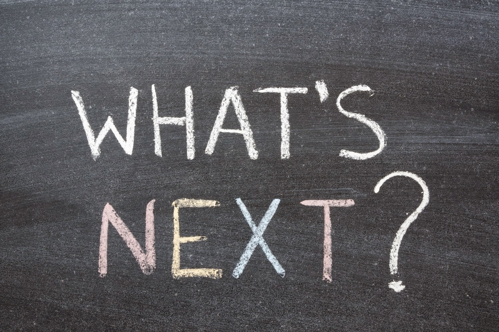 """What's Next"" written on chalkboard"