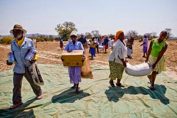 Food aid is distributed during a drought in Zimbabwe by Aktion Deutschland Hilft, 2007 (Credit: World Vision) Click to enlarge.