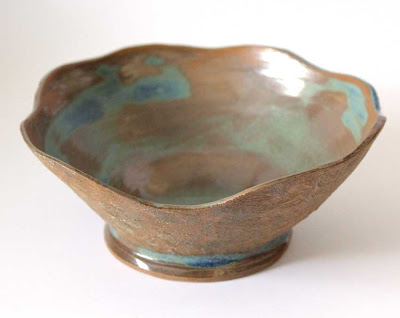 wavy edged carved clay bowl