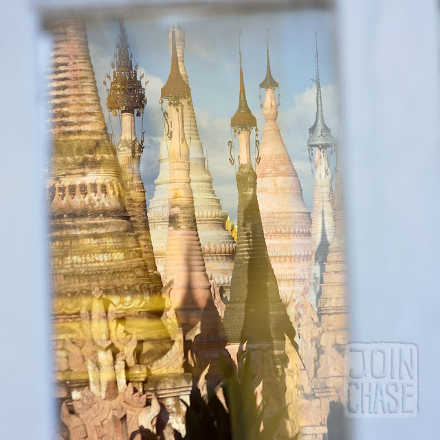A window reflection of pagodas outside of Taunggyi in Shan State, Myanmar.