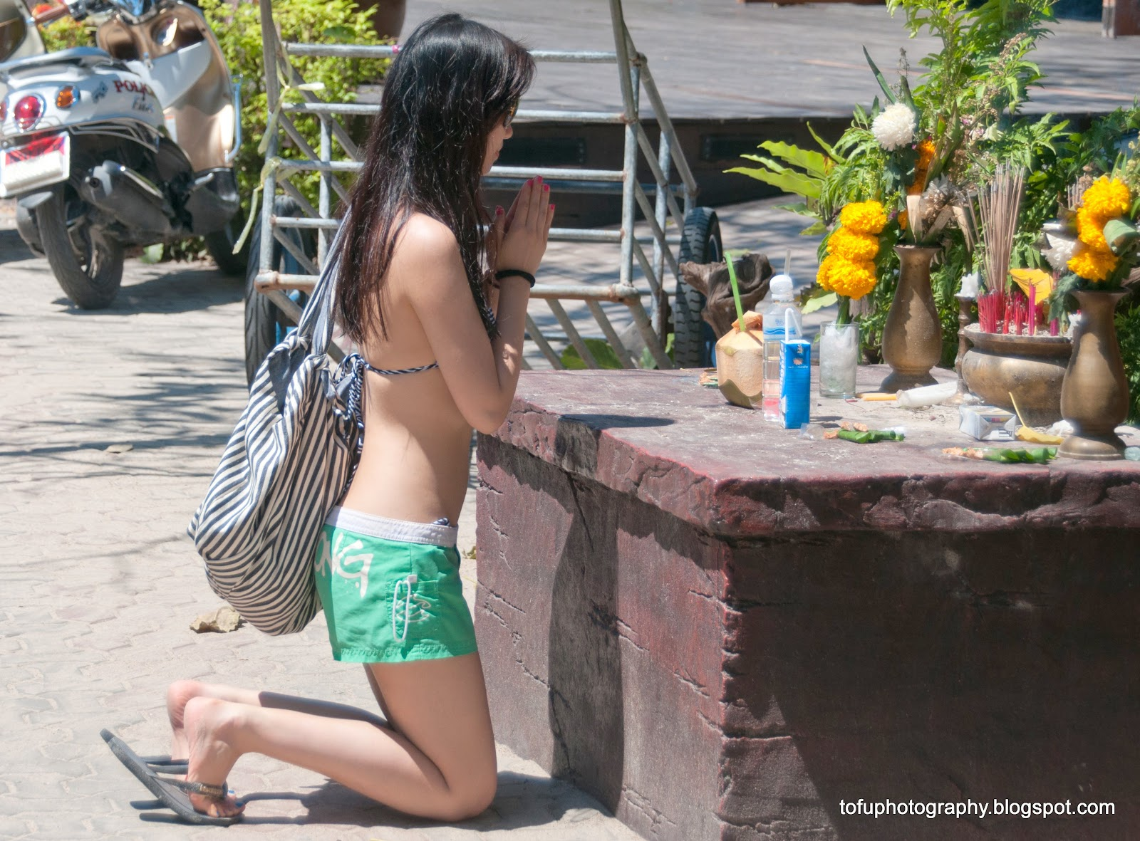 Sexy woman praying in Thailand.