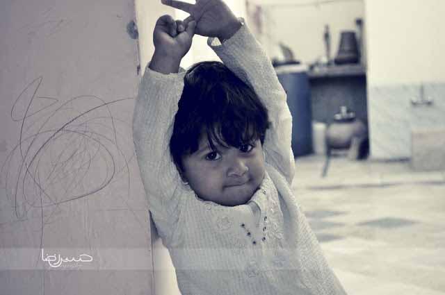 Innocent little angel making smiling pose