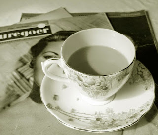An art deco cup on top of 1930s film magazines