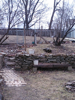 Yard devoid of snow, brown, and wet.