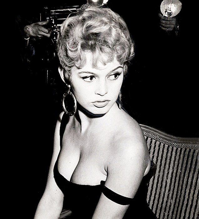 Bridgette Bardot in a black dress showing cleavage