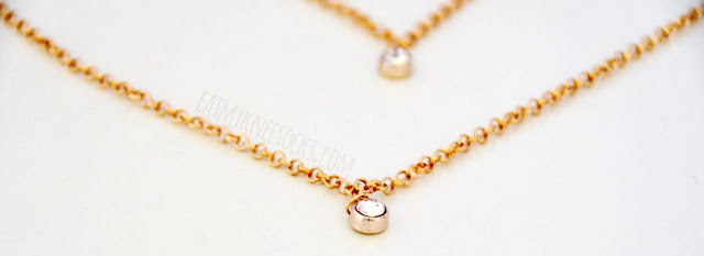 Close-up of the dangling gemstones on the golden body chain from Born Pretty Store.