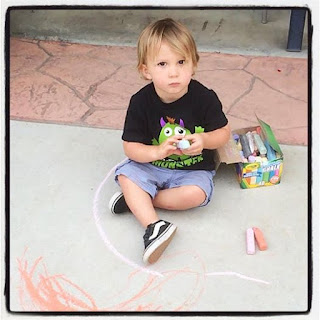 Reef enjoys his creative side with concrete chalk.