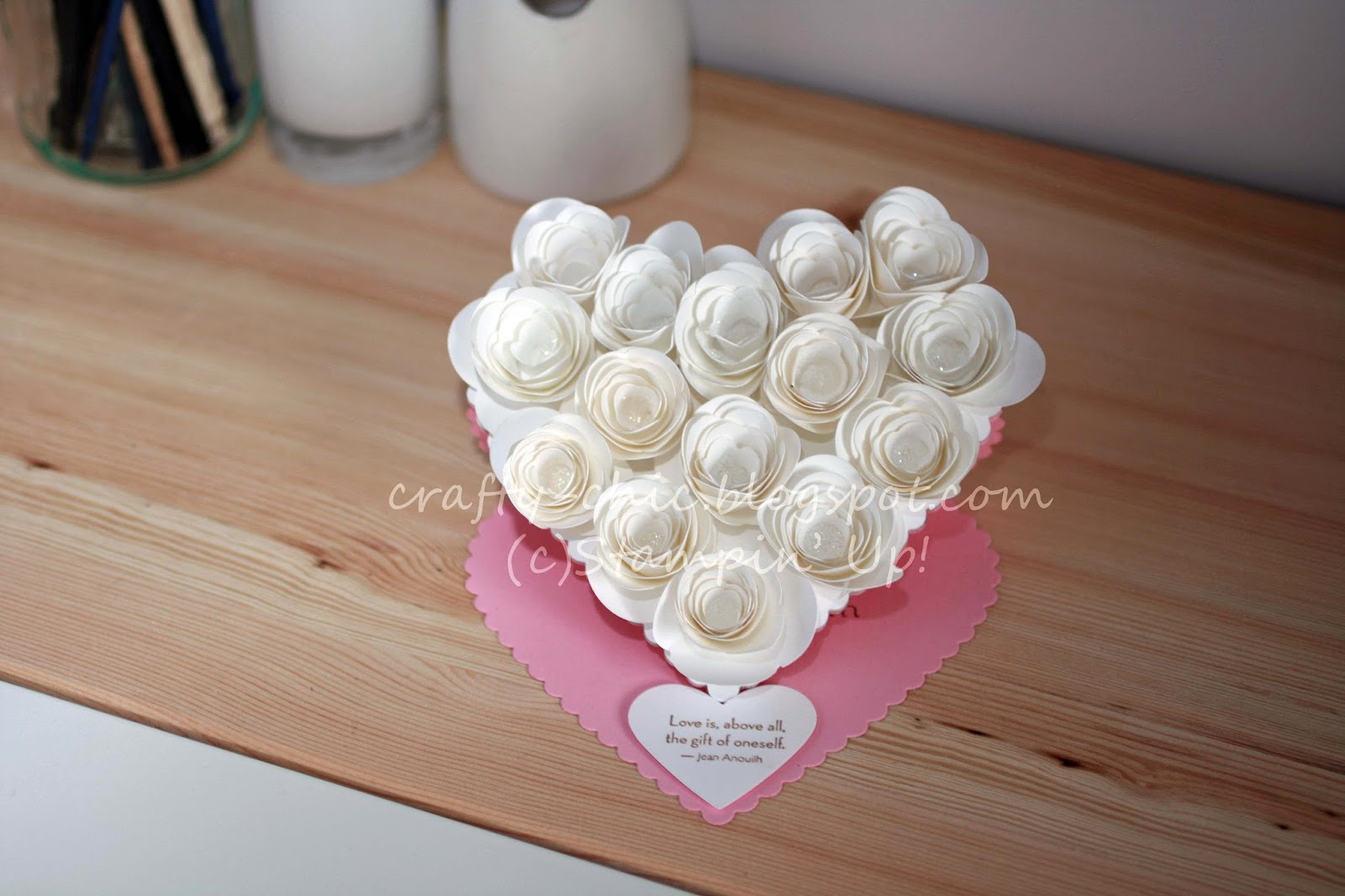 A heart shaped easel card with 3d flowers