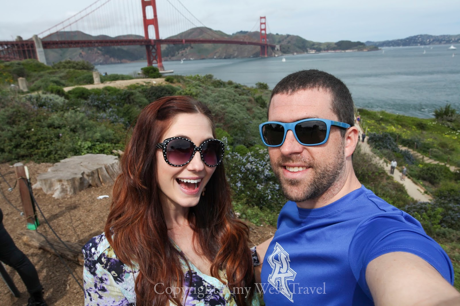 Amy West and husband David in front of the Golden Gate Bridge