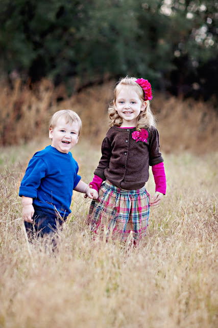 Brother and sister play in Tucson field during family photo session