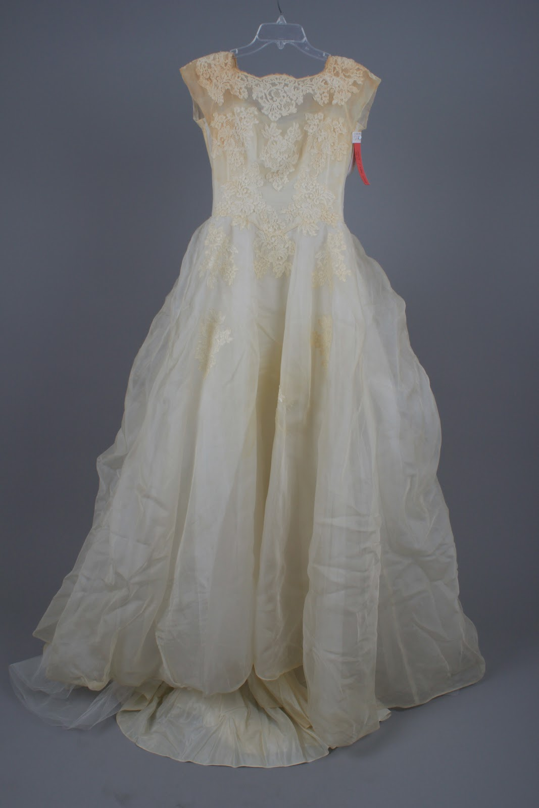 Bridal gown cleaning preservation follow a 50 year old for Restoring old wedding dresses