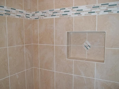 accent tiles in wall band and niche jazz up tan tile surround