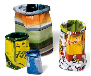 colorful wastebaskets made from old billboards, in multiples sizes