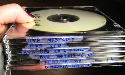 [Image: All the jewel cases painted, with the text clearly showing against the now pink glittery background.
