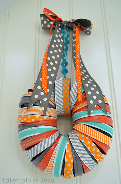 http://tatertotsandjello.com/2013/09/halloween-mason-jar-washi-tape-wreath.html