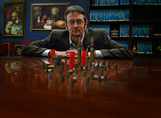 Dr. William Wells poses with a variety of bullets.