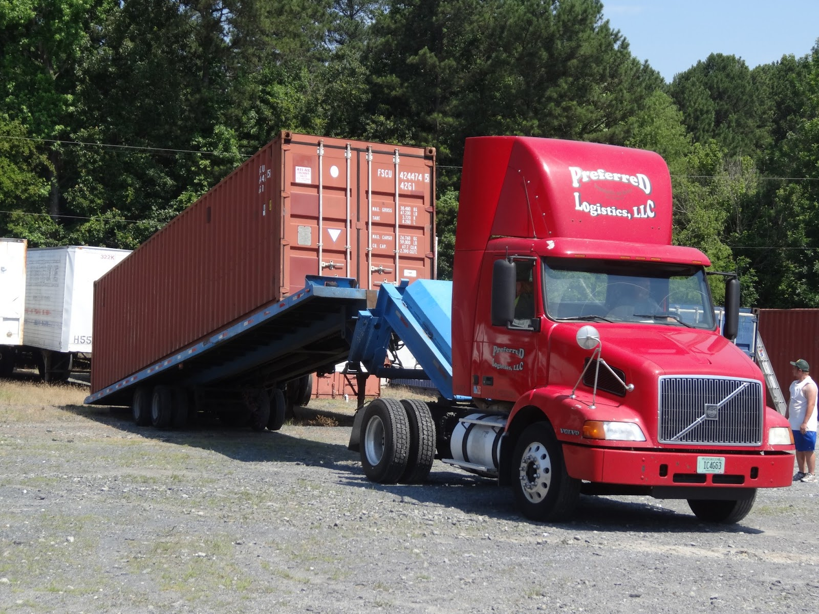 How to move a ground level shipping container for storage use