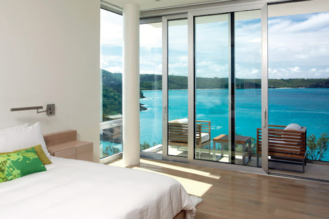 Floor to ceiling windows in the bedroom