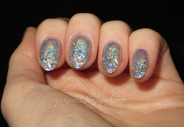 Holographic glitter tips featuring Venique Twinkling Glitter, Ozotic 509, Nubar Hologram Glitter, Wet n Wild Cheers
