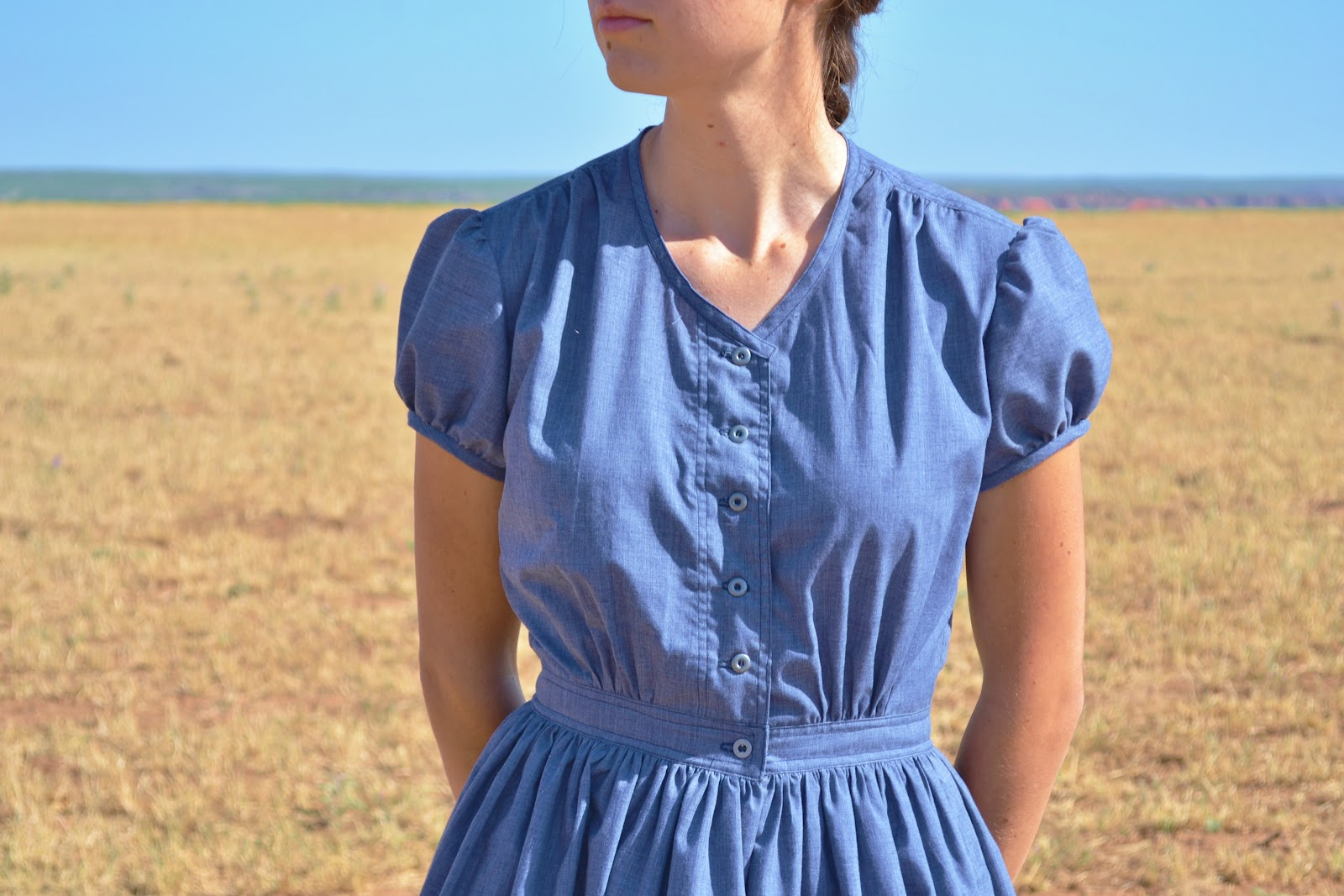 The fabric is a very lightweight cotton almost a lawn though its woven to mimic denim and the dress is unlined