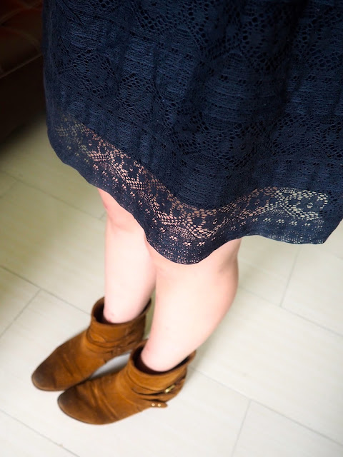 Shades of Midnight | outfit details of floral lace pattern on dark blue skirt, with brown suede ankle boots