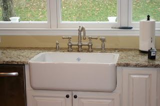 Shaw's farm sink and Graff bridge faucet via www.goldenboysandme.com