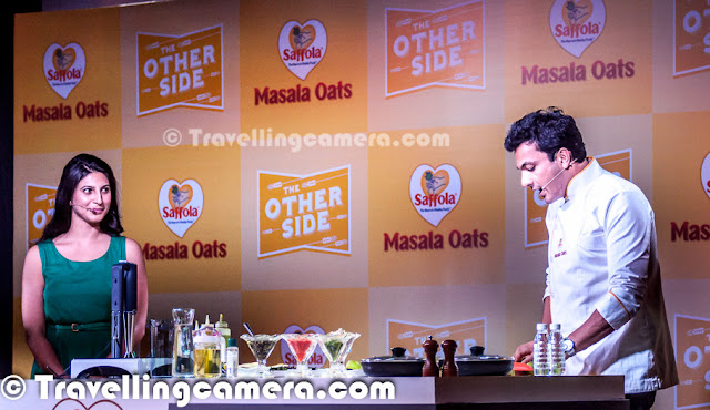 Yesterday we had an invite to participate in a Blogger Meet organized by Saffola Masala Oats and Vikas Khanna was main guest there. He flew from US to India for this event and it was really an exciting opportunity for us to interact with one of the best Chefs in the world. After meeting I found him a great person as well.Let's check out this Photo Journey and know more about my personal experiences of this sepcial day with Bindas Punjabi who is based in US now.   Usually such blogger meets are great ways to interact with other bloggers from North India, but this time most of the bloggers were excited to meet Vikas Khanna in Person. Almost every blogger was on time and as expected Chef Vikas Khanna made us wait for some time but it was worth. As he joined us at Blue Frog with his amazing smile, the whole environment changed immediately. Probably I was least aware of him. I knew very basic stuff about him and everyone else had probably all details about his past life and his lifestyle. Girl Bloggers were really mad about the event and we could literally see lot of unusual stuff that doesn't happen during other meets. Anyways, it was great to meet him in person and understand the great Chef.   I loved when we started talking in Punjabi & Hindi, although he couldn't control to talk in English in between. His style was awesome and he was continuously cracking some subtle Punjabi jokes in between. Of course, he shared some great tips about food and how different ingredients can be used in innovative way.   Born in Amritsar, Vikas Khanna began his culinary experience as a helper in his grandmother's kitchen and learned the art of cooking & the use of spices from her. He talked about his mom many times and related food with love. And had some great views about food and mothers who feed the whole family with love. He began developing recipes at a very young age. He graduated from the Welcomgroup Graduate School of Hotel Administration and established SAANCH, a cultural festival gala, to bring together various foods and traditions from different parts of India. This festival has been an important event in the college's calendar. He has worked for the Taj, Oberoi, Welcomgroup and Leela Group of Hotels and with some of the most influential chefs of the world including Gordon Ramsay, Bobby Flay, Jean-Georges Vongerichten.  Above photograph shows Vikas interacting with bloggers who participated in cooking contests. And there were two contestants out of 12. He really impressed everyone out there. Chef Vikas Khanna completed his graduation from Welcomgroup Graduate School of Hotel Administration also known as WGSHA, Manipal.He has also studied at Cornell University, Culinary Institute of America, and New York University. Vikas also appears in Marquis Who's Who in America 2012 edition.    He himself made two dishes and talked a lot of Tindas :). And I can't believe the depth he reached while talking about tindas and various ways to cook it. btw, Saffola Masala Oats were the highlight of the event. Second round of cooking involved dishes created with Oats. Vikas met all contestants, talked about their ideas and tasted their dishes. Oat Pizza was one of his favorites which also won the contest. Check out more about Vikas Khanna @ http://en.wikipedia.org/wiki/Vikas_Khanna
