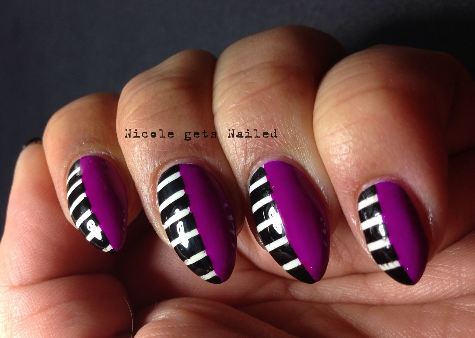 Nicole gets Nailed: Purple Up!
