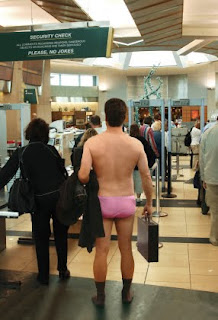 Man stripped down to underpants, waiting to pass airport security