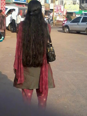 Loose long haired Kerala girl wearing churidar.